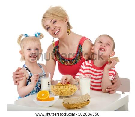 Happy family having breakfast. isolated on white background - stock photo