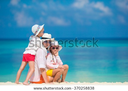 Happy family having fun at exotic beach in tropicl island
