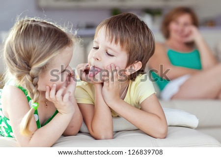 Happy family having fun at home, laughing. - stock photo