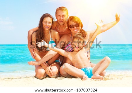 Happy Family Having Fun at the Beach. Joyful Big Family. Vacation and Travel concept. Summer Holidays. Parents with Children enjoying a holiday at the sea  - stock photo