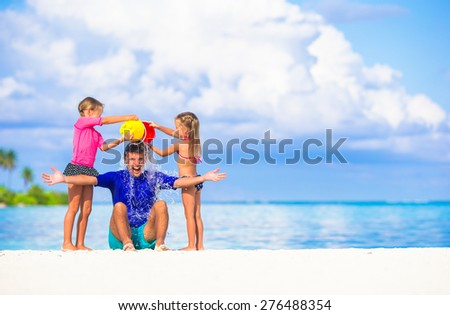 Happy family having fun during summer beach vacation - stock photo