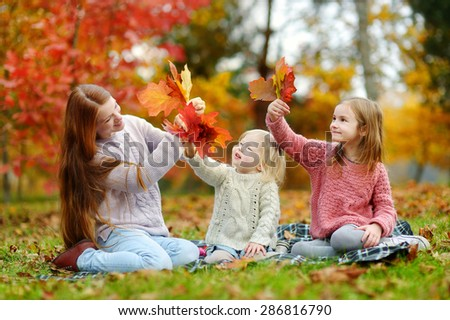 Happy family having fun on beautiful autumn day - stock photo