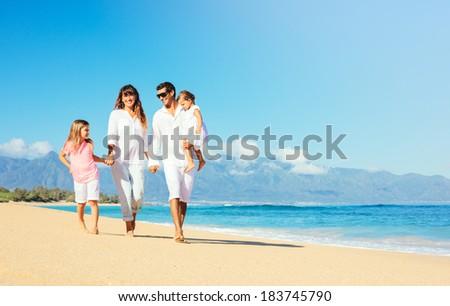 Happy Family Having Fun on Beautiful Sunny Beach - stock photo