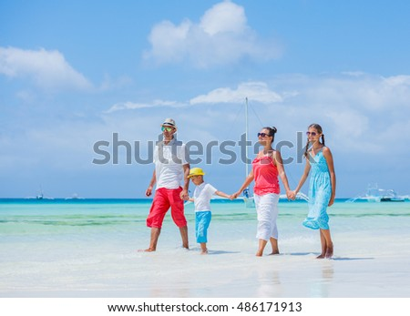 Happy family having fun on tropical beach