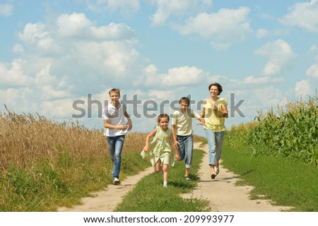 Happy family having fun outdoors against the sky