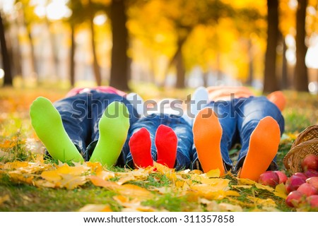 Happy family having fun outdoors in autumn park - stock photo