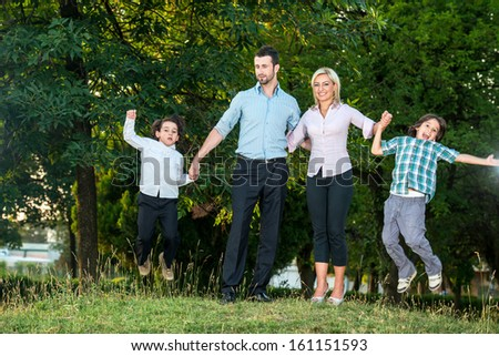 Happy family having fun outdoors in the park