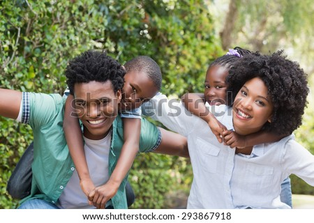Happy family having fun together in the garden at home - stock photo