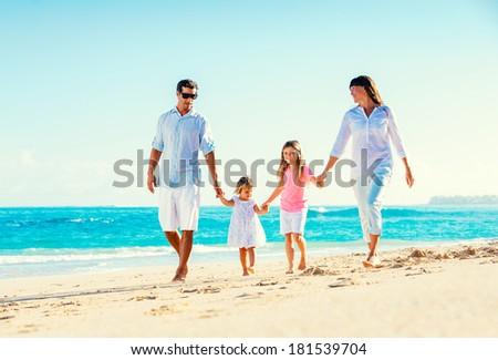 Happy Family Having Fun Walking on Tropical Beach - stock photo