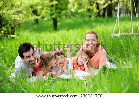 Happy family having picnic in nature - stock photo
