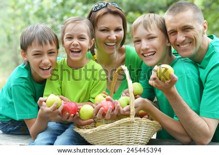 Happy Family having picnic in summer park - stock photo