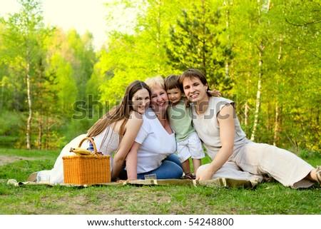 happy family having picnic in the nature - stock photo
