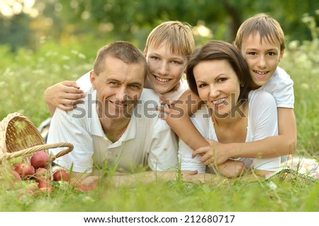 Happy Family having picnic on green summer grass