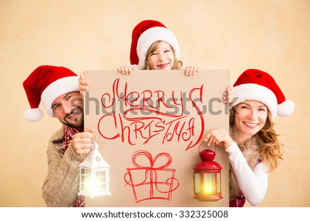 Happy family holding Christmas banner blank. Xmas holiday concept - stock photo