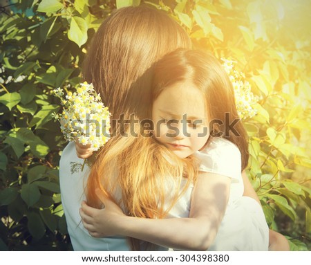 Happy family holding flowers - stock photo