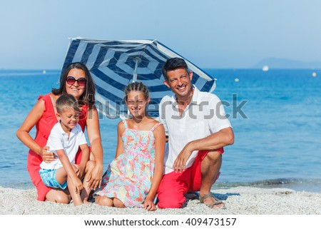 Happy family holidaying on a sandy beach