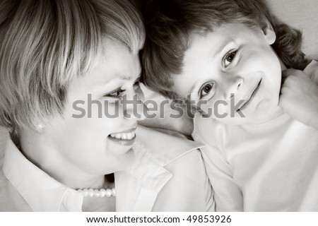 happy family home: mother and - black and white photo - stock photo