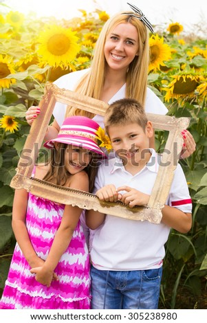 Happy family in a frame - stock photo