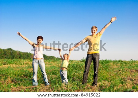 happy family in a meadow