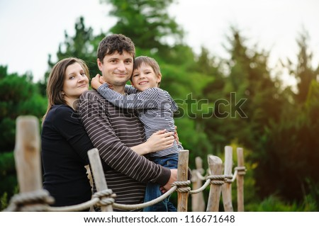 Happy family in a park - stock photo