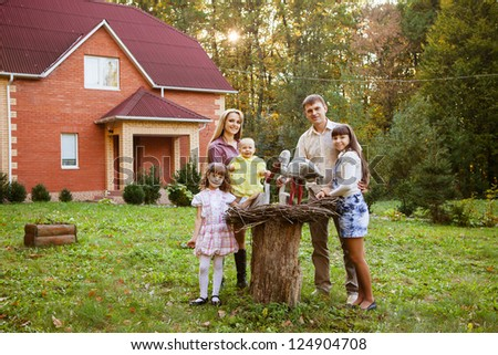 happy family in backyard of new home - stock photo