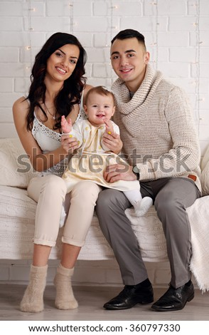 happy Family in bed playing and smiling - stock photo