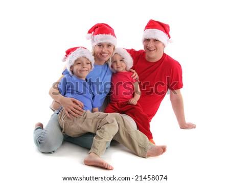 Happy family in Christmas hats 2 - stock photo
