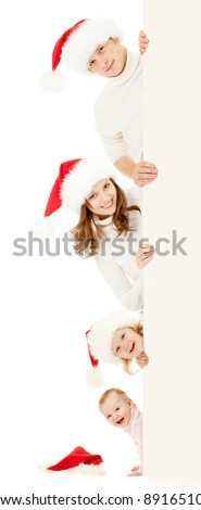 happy family in Christmas Santa's hats holding big banner for your advertisement isolated on white - stock photo