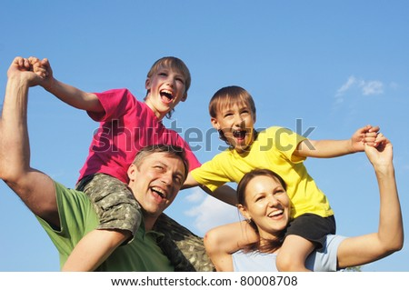 happy family in color clothes at nature