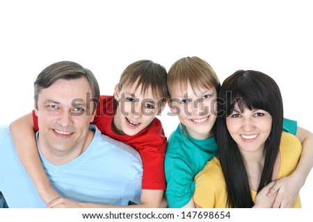 happy family in colored T-shirts spend time together - stock photo