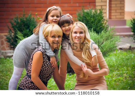 happy family in garden - stock photo