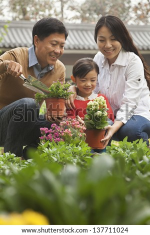 Happy family in garden - stock photo
