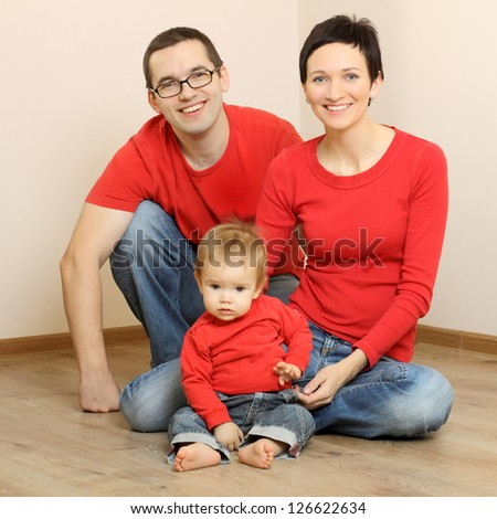Happy family in jeans and a red shirts