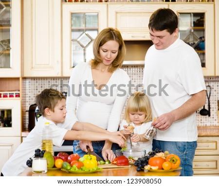 happy family in kitchen - stock photo