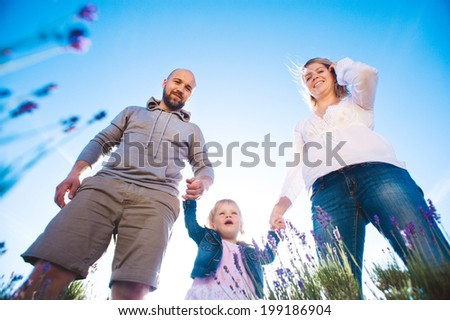 Happy family in lavender field  - stock photo