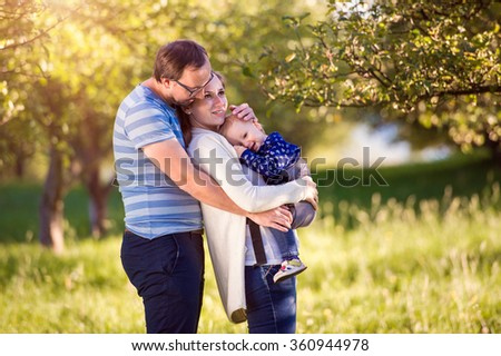 Happy family in nature - stock photo