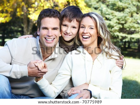 Happy family in park. Father, mother and son