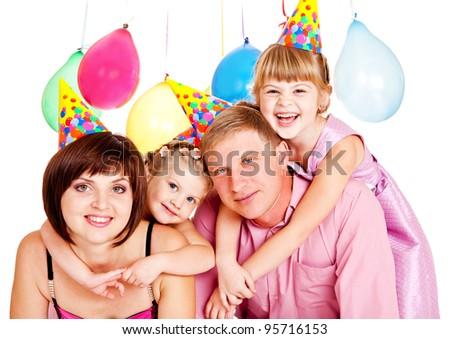 Happy family in party hats celebrating birthday - stock photo