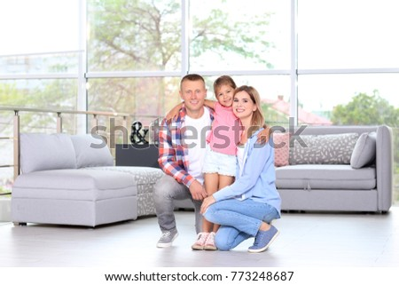 Happy family in room at new house
