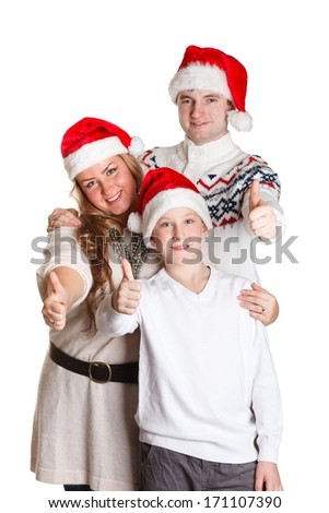 Happy family in Santa Claus caps showing sign ok on a white background.