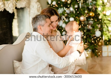 Happy family in the background Christmas tree - stock photo