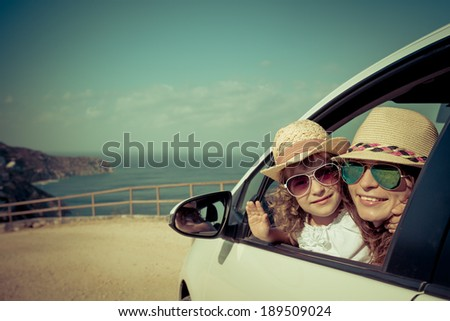 Happy family in the car. Summer vacation concept - stock photo