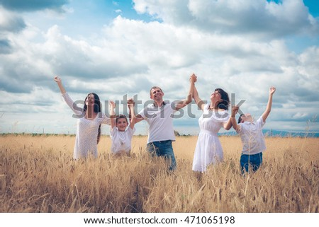 happy family in the field of wheat