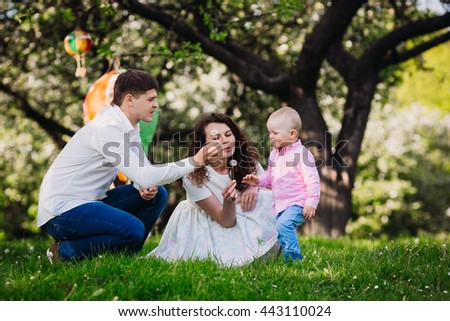 Happy family in the garden - stock photo