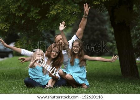 happy  family  in the park  - stock photo