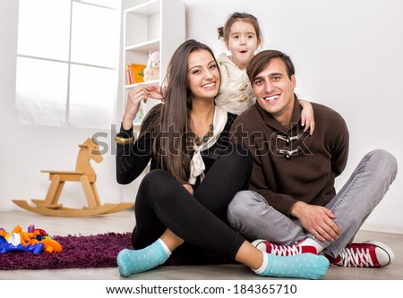 Happy family in the room - stock photo