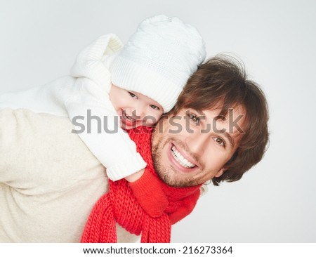 happy family in winter. father dad playing with baby daughter child girl - stock photo