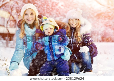 happy family in winter park. people outdoors. funny mommy with her children - stock photo