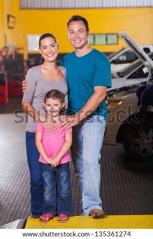 happy family inside car service center - stock photo