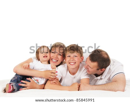 Happy family isolated over white background - stock photo
